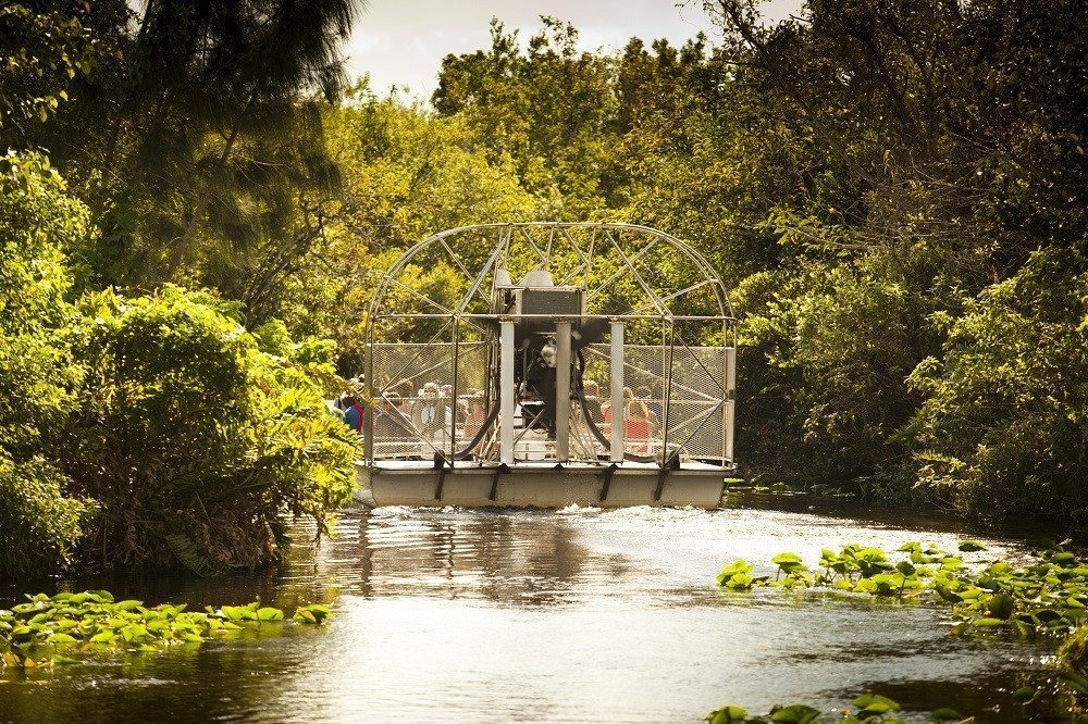 Florida met kids: Street in key west, florida: Swamp boat floats into the Everglades National Park Florida USA